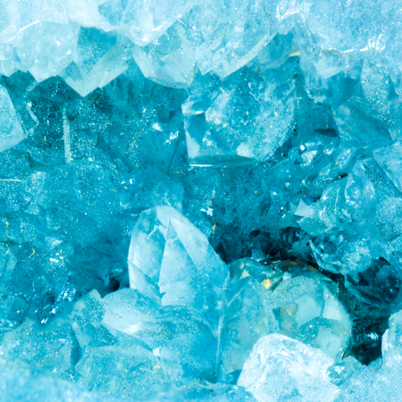 cross section slice detail macro of a aquamarine color geode.Beautiful natural crystals gemstone. Extreme close up macro shot.