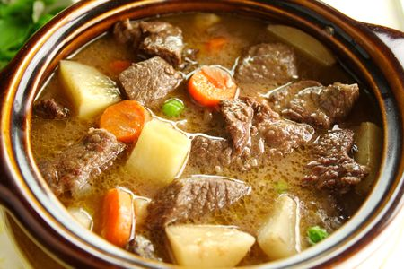 Rich hearty beef stew simmering and ready to serve.