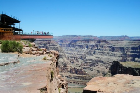 The glass skywalk observation bridge suspended four thousand feet above the Colorado River on the edge of the Grand Canyon West.