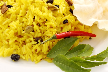 Delicious spicy rice with tumeric, chilli, cardamon and curry leaf.