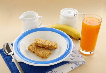 Iconic Australian breakfast cereal Weet Bix served with juice and milk.