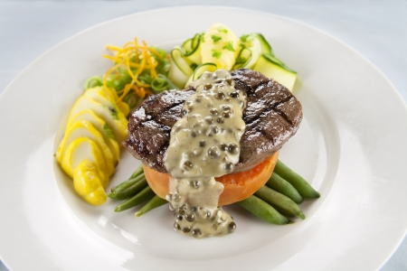 Chargrilled steak on sweet potato with green peppercorn sauce.