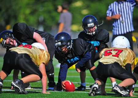 September 24, 2011 American Football (Youth 5-6th Gr) Oregon's Forest Grove HS Vikings Youth  V Hillsboro Century HS Jaguars Youth.   Century Jags take control of the scrimmage line as the ball is ready to be put into play. Score not kept.