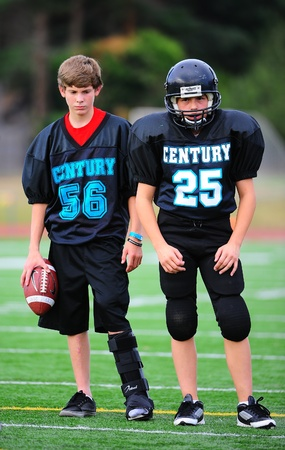 September 21, 2011 American Football (Youth 7-8th Gr) Hillsboro Or Century HS youth V Forest Grove Jr High Titans. Century Jags #56 & #25 watch practice.  #56 sporting a boot on his lt foot from a prior injury.  Final score 34-26  Forest Grove