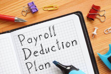 Foto de Payroll Deduction Plan is shown on the conceptual business photo - Imagen libre de derechos