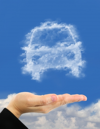 car symbol made of clouds  over hand