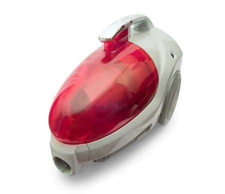 Red household vacuum cleaner on white