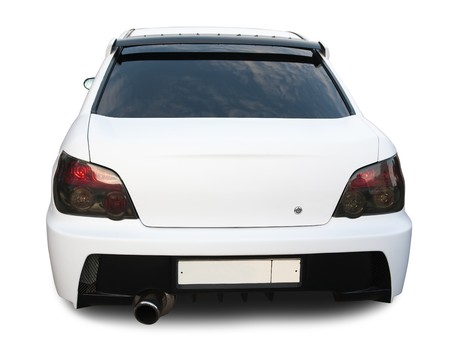 Rear view of white car on white.