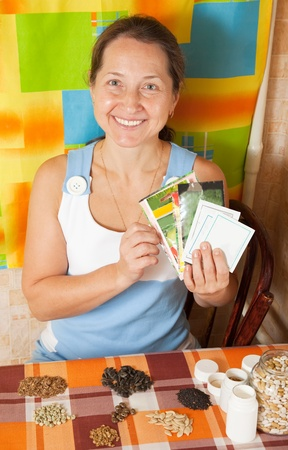 Mature woman with  various seeds at home