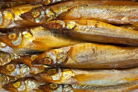 background of  golden  smoke-dried  fish close up