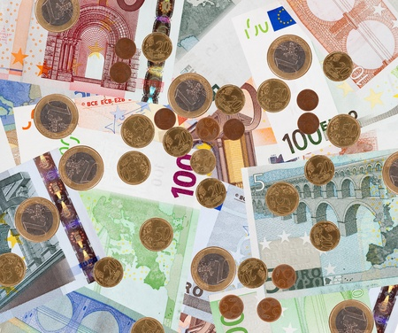 Background of many euro banknotes and coins
