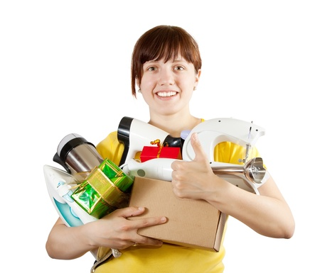 young woman with heavy-handed of household appliances over white