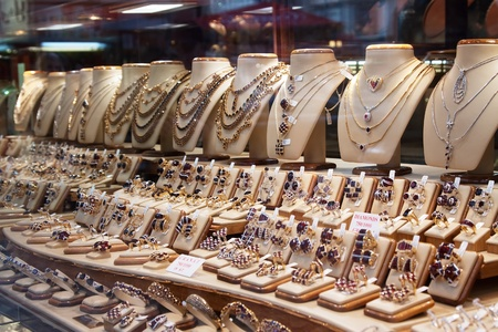 counter with variety of jewelry in store window