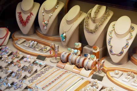 counter with a variety of jewelry in store window