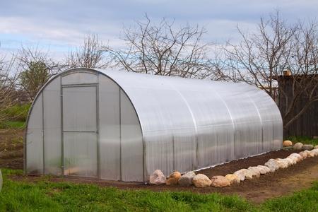 New modern  greenhouse at garden in spring