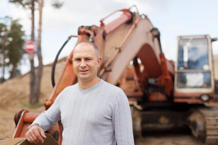 Portrait of tractor operator at sand pit