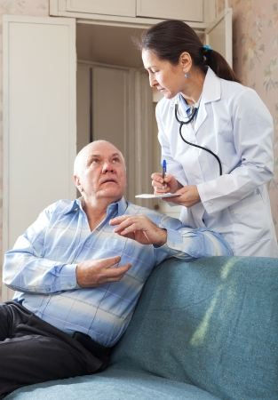 Friendly doctor asked senior patient feels