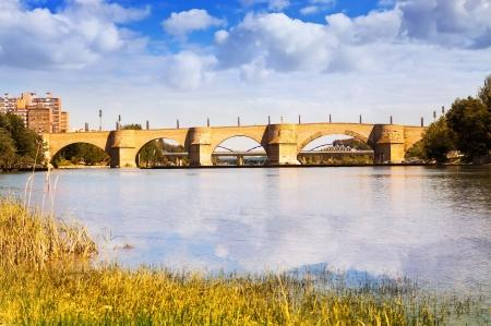 Stone bridge over Ebro river in Zaragoza