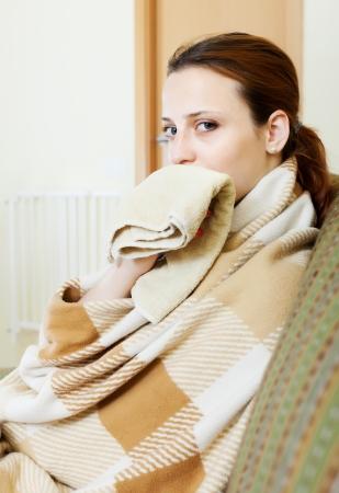 illness woman in warm plaid with handkerchief