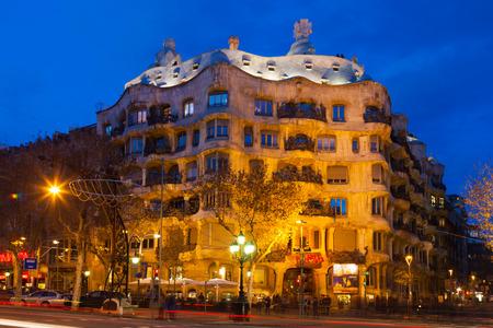 BARCELONA, CATALONIA - JANUARY 2, 2014: Night view of Casa Mila  in Barcelona, Catalonia. House was built in 1905–1910 by Catalan architect Antoni Gaudi
