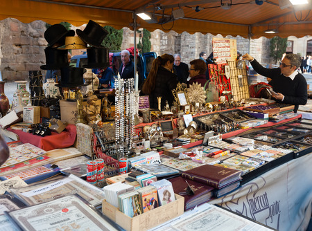 BARCELONA, SPAIN - FEBRUARY 20, 2014: Counter with vintage things at flea market before Barcelona Cathedral