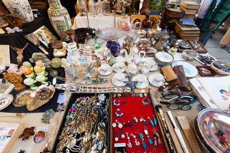 BARCELONA, SPAIN - FEBRUARY 20, 2014: Counter with vintage things at flea market at square before  Cathedral