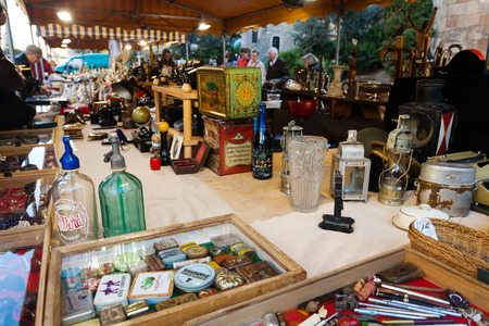 BARCELONA, SPAIN - FEBRUARY 20, 2014: Counter with vintage things at flea market at square before Barcelona Cathedral