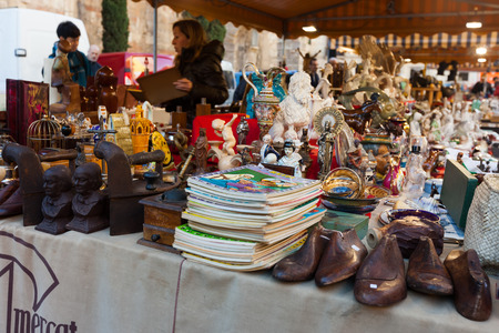 BARCELONA, SPAIN - FEBRUARY 20, 2014: Old things at flea market at square before  Barcelona Cathedral