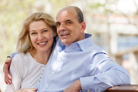 Foto per Happy mature couple together in summer park - Immagine Royalty Free