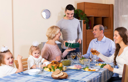 Photo pour Big smiling family celebrating birthday at festive dinner - image libre de droit