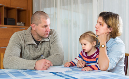 Serious parents discussing parental guardianship before divorce