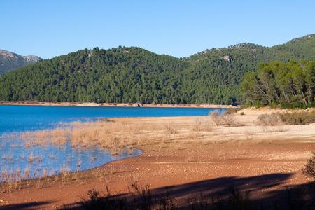 Mountains river with island. Isla Cabeza de la Vino - Guadalquivir river, Andalusia,  Spain