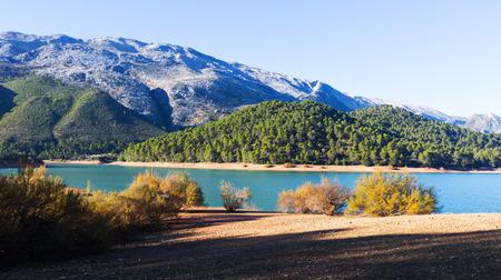 Mountains river with island. Isla Cabeza de la Vina