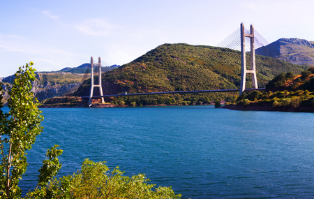 Cable-stayed bridge over reservoir.  Leon