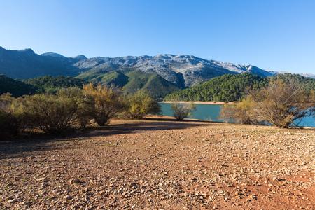 Mountains river with island. Isla Cabeza de la Vina - Guadalquivir river, Andalusia