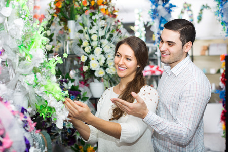 Happy adult couple in a flower shop