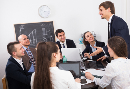 Professional team discussing business project at corporate meeting in office