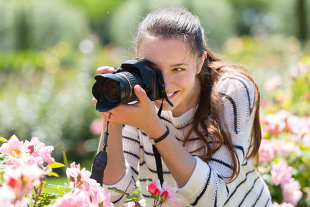 Photo for beautiful female photographer with camera outdoor - Royalty Free Image