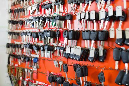 Assortment of car key duplicates at display in locksmith