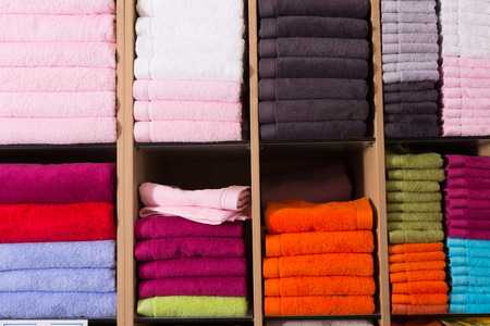 stack of accurately lying bad towels on shop shelves in textile department