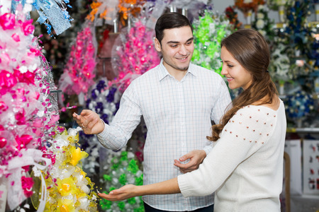 young couple buying flowers in a store