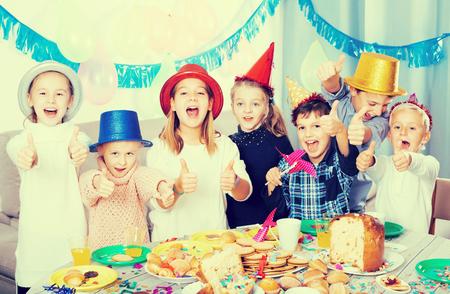 Smiling children having party to celebrate  friend?s birthday