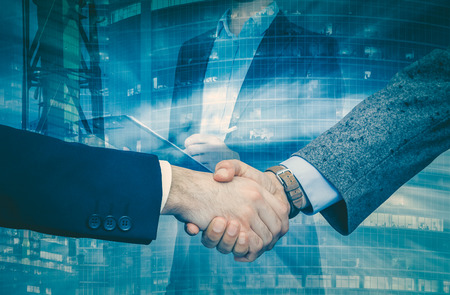 Photo for Strong handshake of businessmen confirming successful business partnership - Royalty Free Image