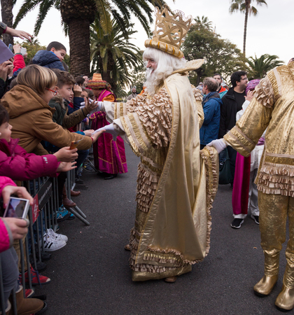 BARCELONA, SPAIN –  JANUARY 5, 2017: King Melchor with entourage takes letters from children. Barcelona, Spain