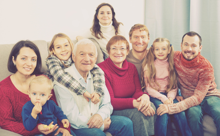 Photo for Family members making family photo during a reunion party - Royalty Free Image
