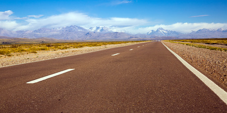 View from highway to mountains in vicinity of Las Lenas in summer day. Andes, Argentina