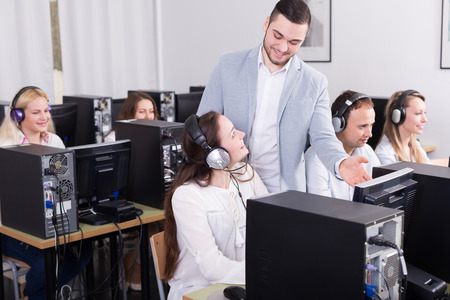 Positive boss and his successful call center team at office