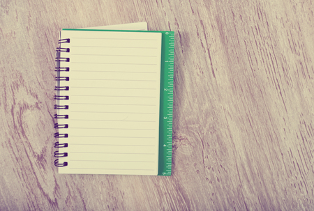 Open notebook with pages in line on table