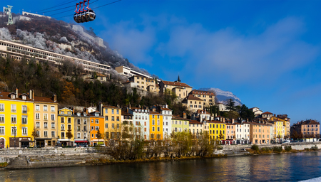 Image of cable cars in Grenoble in autumn over riverside, France