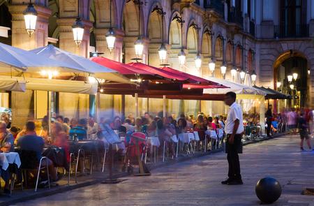 Nightlife of popular lively Placa Reial in Barcelona, Spain